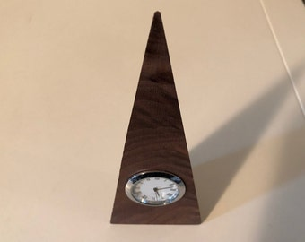 Figured black walnut desk clock with white and silvery movement