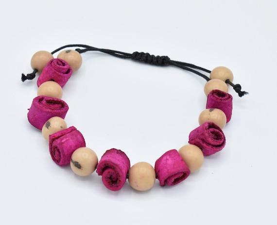 Tagua nut jewelry stretchy bead bracelet dark pink.
