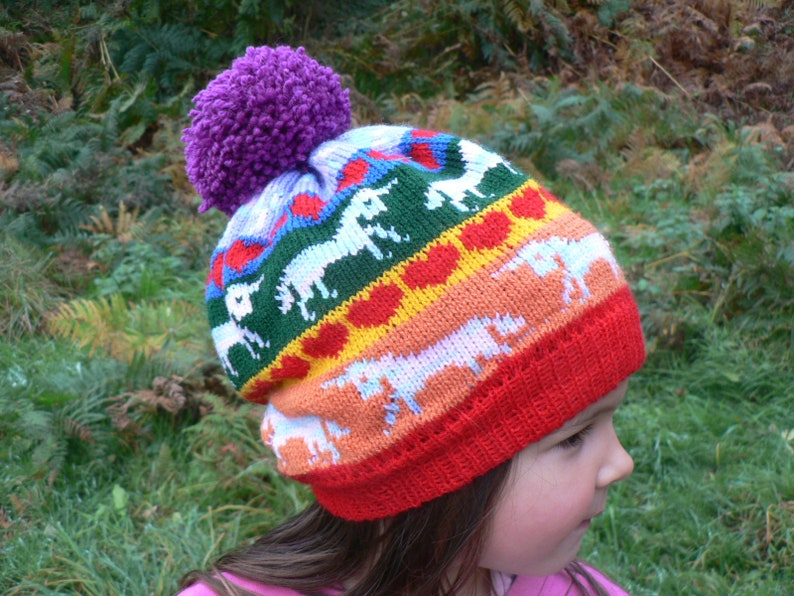 84ad0a77e81a1 Rainbow Unicorn and Hearts Knitted Pom Pom Hat   Bobble Hat