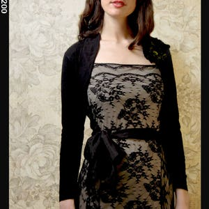 Shrug coverup in black,red,purple,chocolate,blue,pink,ivory,reef or soft green wool.