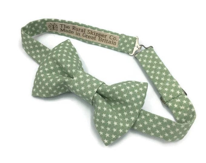 Pastel green cotton bow tie with star print design.