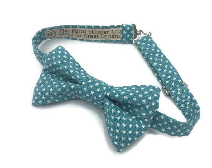 Blue cotton bow tie with white star print design.