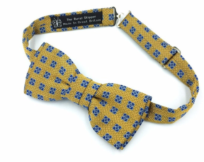 Gold and navy silk bow tie, gold and blue pattern silk bow tie.