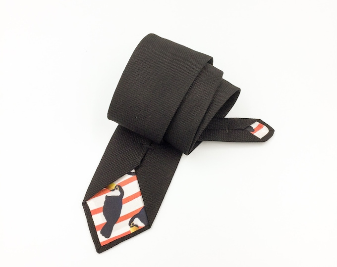Men's black tie, black tie with Tucan printed lining, black silk jacquard woven tie.