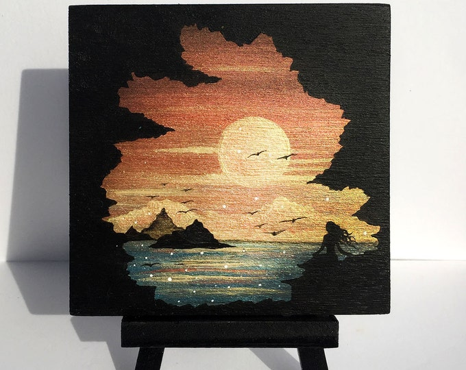 woman observing sunset -  cave - silhouette - miniature miniature limited edition print mounted on wood
