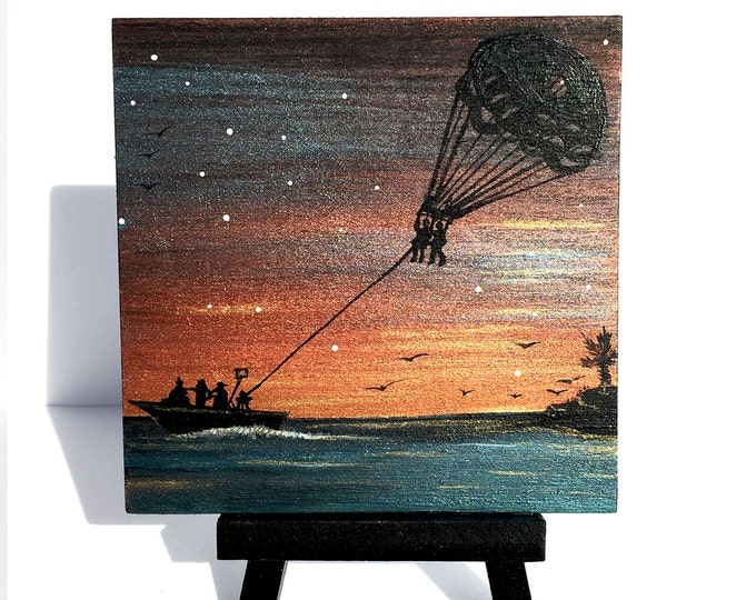 parasailing at sunset - silhouette - miniature miniature limited edition print mounted on wood