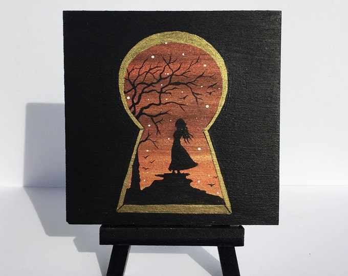 Keyhole view - woman -  sunset -  silhouette - miniature miniature limited edition print mounted on wood