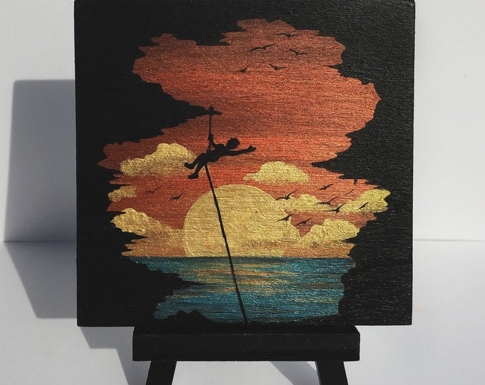 Sunset rock climbing - cave -  silhouette - miniature miniature limited edition print mounted on wood