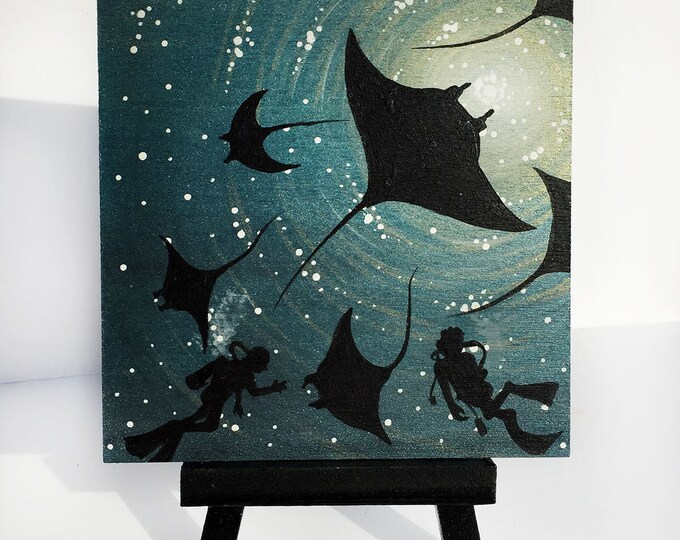 Scuba divers and manta rays swim-   silhouette - miniature miniature limited edition print mounted on wood