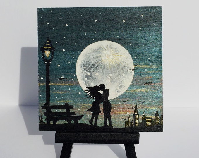 Romantic couple kissing on a full moon night-  silhouette - miniature miniature limited edition print mounted on wood