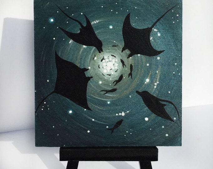 Manta rays swim- underwater-   silhouette - miniature miniature limited edition print mounted on wood