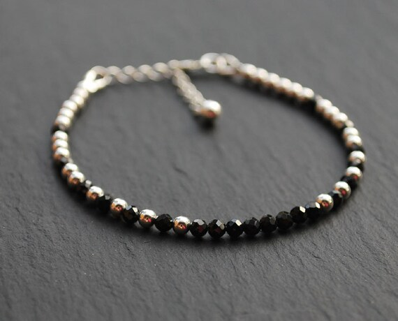 Black faceted spinel silver chain bracelet with 925 sterling silver spacer beads.