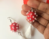 Red ball and white tassel...
