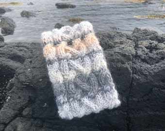 Hand knitted wool headband featuring Celtic knot work pattern. Fleece lined