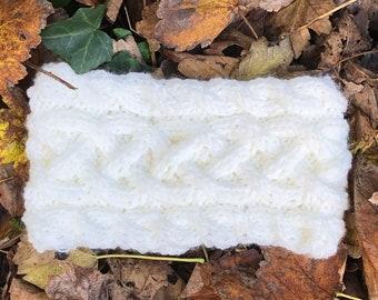 Hand knitted wool headband / earwarmer in Celtic knot pattern. Fleece lined.
