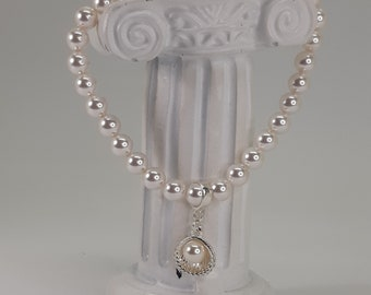 Handmade bridal jewellery, White Swarovski elements crystal pearls, Sterling silver clam shell with pearl