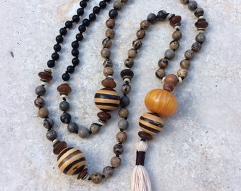 Jasper, onyx and amber mala necklace with tassel. 108 bead mala necklace, hand-knotted and finished with a tassel. Wood, silver and horn.