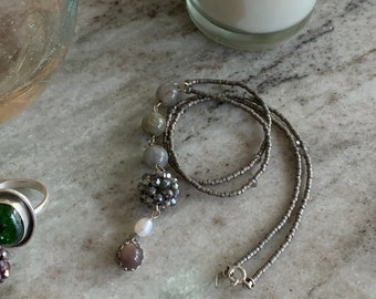 Lariat necklace with labradorite, freshwater pearl, crystal beads and sterling silver clasp.