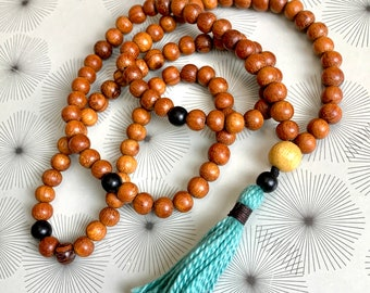 108 bead mala necklace of wood and onyx beads and a turquoise blue handmade tassel - mala beads for spiritual practice or fashion accessory.