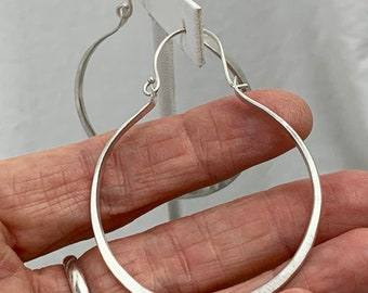 Large silver hoops in recycled sterling with hinged locking ear wires