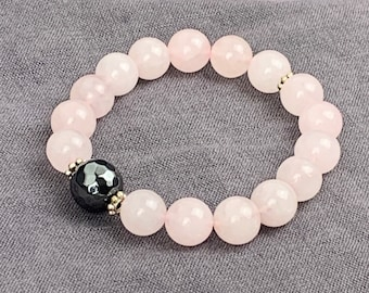 Rose quartz beaded bracelet with hematite accent bead and silver spacer beads