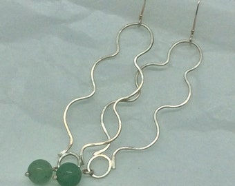 Sterling silver wire dangle earrings with green aventurine bead. Long, curvy design with a single aventurine bead drop. Sterling ear wires.