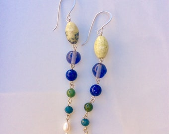 Beaded dangle earrings with yellow turquoise, glass, lapis, pearl and aventurine. Sterling wire and beads linked together in this long pair.