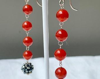 Carnelian drop earrings with a handmade woven beadwork bead.