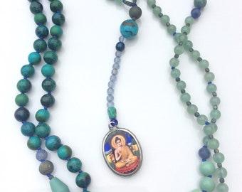 Green and blue stone mala with Buddha charm.