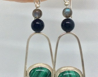 Malachite and sterling silver earrings. Malachite stone set in sterling in a long, dangle design with labradorite and blue goldstone beads
