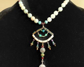 ornate beaded pendant necklace with aquamarine, labradorite and garnet