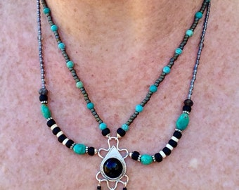 Turquoise and labradorite beaded necklace with black onyx pendant. Onyx set in sterling silver with a double strand beaded necklace.