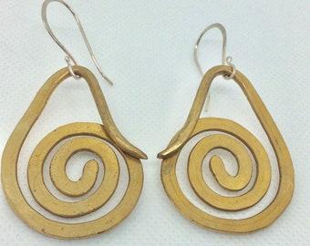 Brass spiral dangle earrings. Heavy gauge brass wire spiral design with sterling silver ear wires.