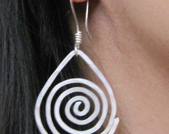 Sterling silver dangle earrings with a spiral design. Long earrings, lightly textured silver spiral with sterling silver ear wires.