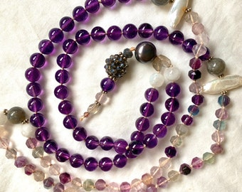 Amethyst bead mala necklace. Long single strand necklace with 108 beads in amethyst, freshwater pearl and fluorite stone.