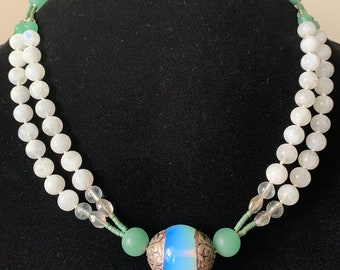 Short necklace of Tibetan glass and silver bead with a double strand of rainbow moonstone, green aventurine, greenberry quartz and labradori