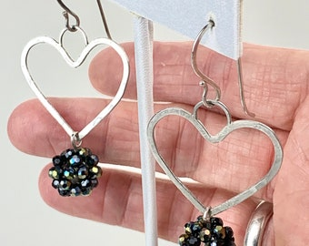Sterling wire heart shaped dangle earrings with a woven crystal bead drop