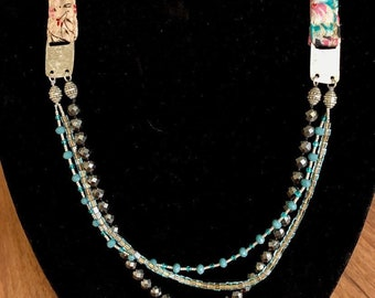 Boho chic multi-strand necklace with silk fabric, sterling silver, faceted hematite and glass. 34 inches long. Mixed media necklace