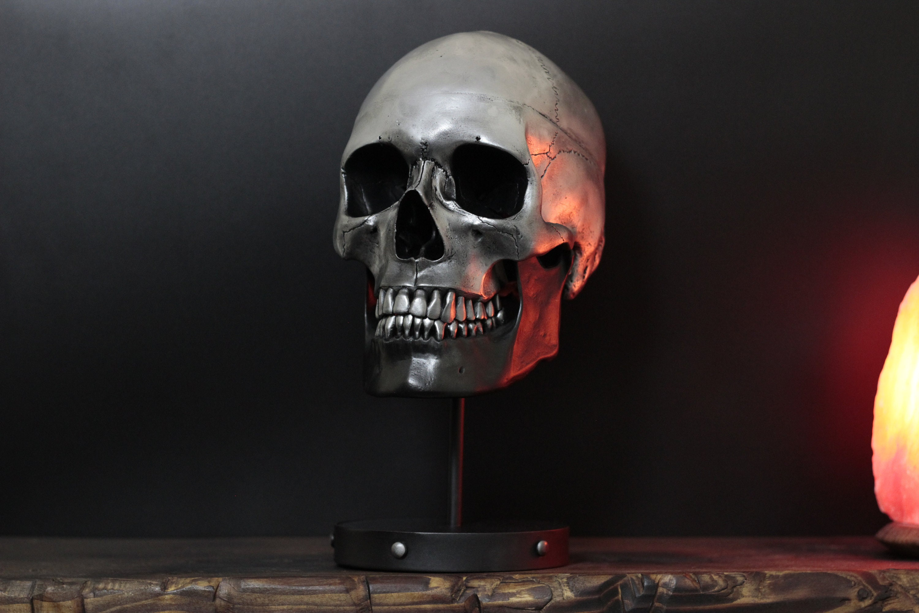 the chrome heart distressed black silver life size skull bust