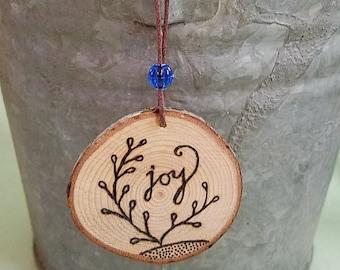 Joy Wooden Ornament with Wood Burning Art as Joyful Keepsake Gift with Recycled Blue Bead on Sustainable Wood Slice, Hostess Gift
