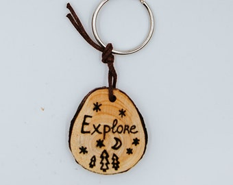 Explore Wooden Keychain Handmade through Wood Burning on Sustainable Wood for Hikers and Travelers