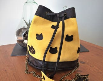 Bucket bag leather yellow and black with cat's heads
