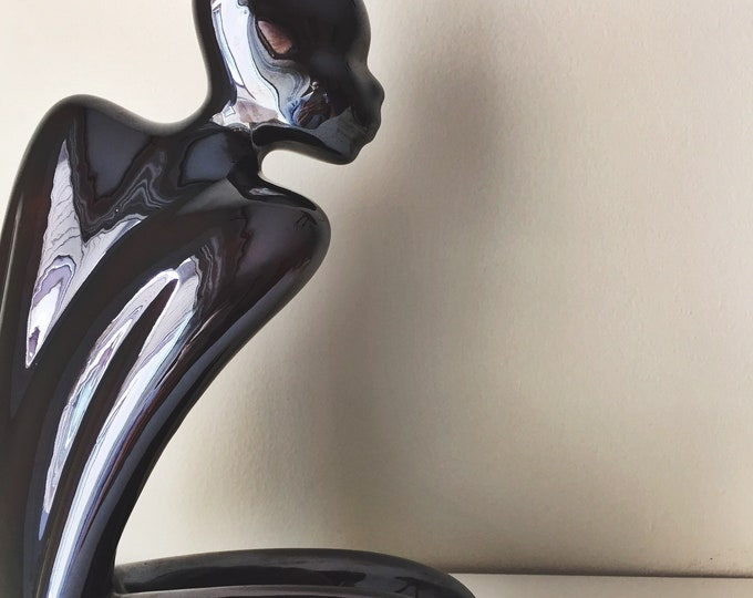 vintage glossy black sculptural porcelain figure