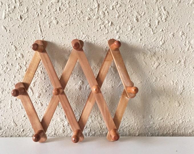vintage small wooden peg rack