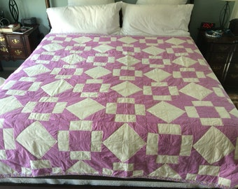 Quilt for sale!Vintage violet quilt. Violet & cream with a border of reproduction 1930's fabric.  Back is a soft cotton white sheet w/ flowe
