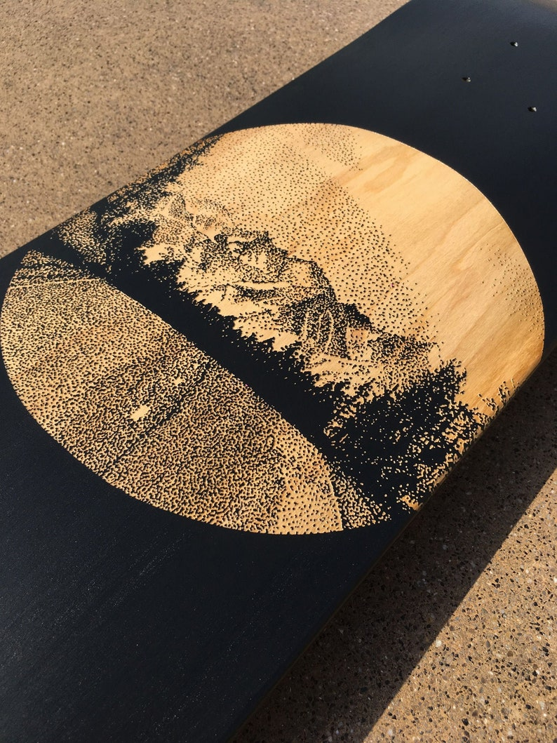 Skateboard art laser engraved in collaboration with artist image 0