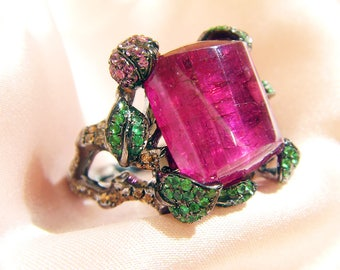 Flower Branch ring 18K black gold with 9.38ct of rubellite and 0.67ct of sapphires,0.26ct of  emeralds