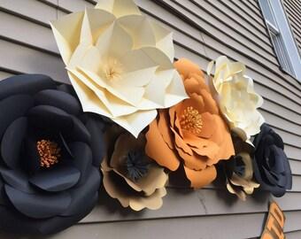 7 Custom Paper Flowers (Orange, black, cream, and gold)
