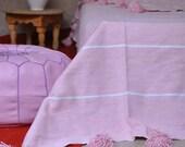 Light pink Moroccan pom pom blanket King Bed size.