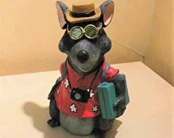 Money box mouse in Hawaiian shirt with camera and suitcase for the travel fund for crafting the holiday decoration